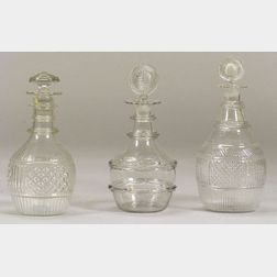 Three Blown Molded Colorless Glass Decanters