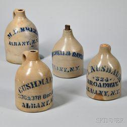 Four Stoneware Advertising Jugs
