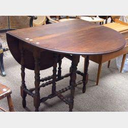 William & Mary Style Mahogany Drop-leaf Gate-leg Table.