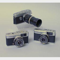 Three Olympus Cameras