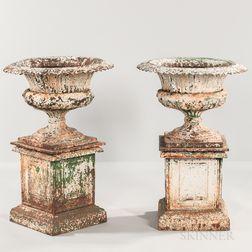 Pair of Painted Cast Iron Garden Urns