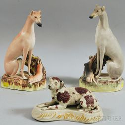 Two Large Staffordshire Pottery Whippet with Game Figurines and a Recumbent Spaniel   Figure