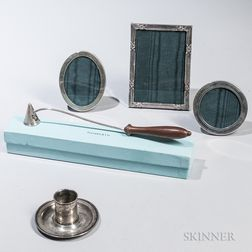 Tiffany & Co. Sterling Silver Snuffer, Three Silver Picture Frames, and a Chamberstick.     Estimate $400-600