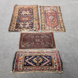 Four Small Rugs