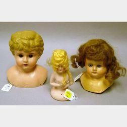 Two Doll Heads and a Half Doll