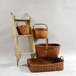 Four Woven Splint Baskets and a Three-tier Hanging Wall Shelf.     Estimate $200-300