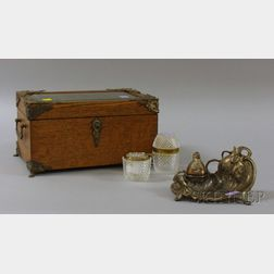 Late Victorian Brass-mounted Oak and Beveled Glass Jewel Casket, an Art Nouveau Silvered Metal Figural Inkwell,...