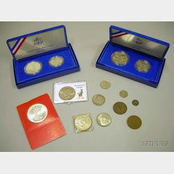 Two 1986 Liberty Dollar and Half Dollar Proof Sets, a 1972 Cayman Islands $25 Coin, a 1972 Eisenhower Dollar, a...