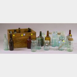Thirty-one Assorted Colored Molded Glass Bottles and Jars