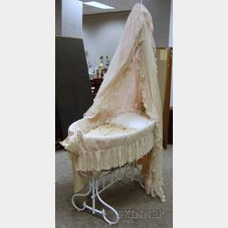 French White-painted Cast Iron Babys Bassinet with Mesh Canopy and Skirt.