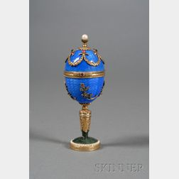 Russian Goldwashed Silver, Enamel, and Stone-set Egg on Stand
