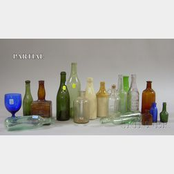 Approximately Sixty-four Assorted Glass and Stoneware Bottles
