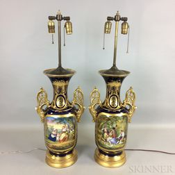 Pair of Continental Gilt and Hand-painted Porcelain Urns