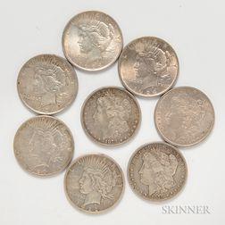 Three Morgan Dollars and Five Peace Dollars