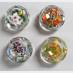 Four Rick Ayotte Faceted Glass Paperweights