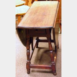 William & Mary Style Cherry and Maple Drop-leaf Butterfly Table.