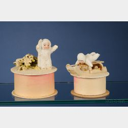 Two Bisque Snow Baby Candy Containers