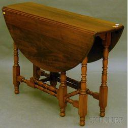 William & Mary-style Mahogany and Walnut Drop-leaf Gate-leg Table.     Estimate $100-200