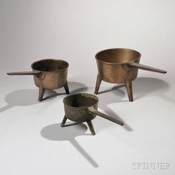 Three Small Bronze Posnets