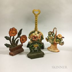 Four Polychrome Cast Iron Floral Doorstops