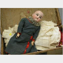 Kestner Bisque Head Doll and Clothing in a Hide-covered Trunk