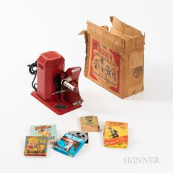 """Excel """"One Redskin"""" Toy Movie Projector and Four Films.     Estimate $20-200"""