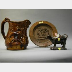Rockingham Glaze Pitcher, Bennington Cow Creamer and a Continental Carved Wood Plaque.