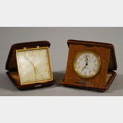 Two Leather-cased Travel Alarm Clocks