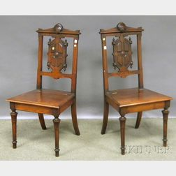 Pair of Victorian Renaissance Revival Carved Walnut Lift-seat Hall Chairs.