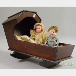 Two Small Bisque Head German Dolls in Hooded Cradle
