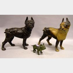 Two Painted Cast Iron Boston Terrier Doorstops and a Small Patinated Bronze Bulldog Figure.