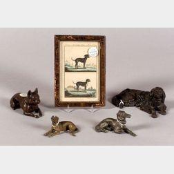 Four Metal Recumbent Dog Figures