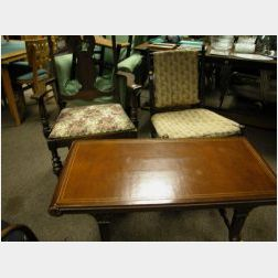 Maple Armchair, a Heywood Wakefield Wicker Armchair, and a Regency-style Leather Inset Mahogany Coffee Table.