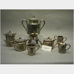 Seven-Piece Wilcox Silver Plated Tea and Coffee Service, Aesthetic Basket and Two Moustache Cups and Saucers.