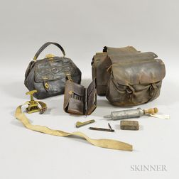 Leather Saddle Bag, Travel Set, an Embossed Leather Bag, and Other Miscellaneous Items.     Estimate $100-150