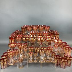 Sixty-eight Pieces of Gilt Cranberry Overlay Glass Stemware