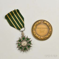 Chevalier of the Order of Arts and Letters Enameled Medal and an Arnold Bax Memorial Medal.     Estimate $60-80