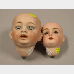 Two German Bisque Socket Doll Heads