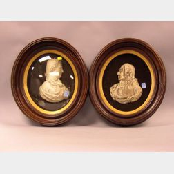 Pair of Oval Walnut Framed Painted Molded Copper Profile Bust Portraits of George and Martha Washington.