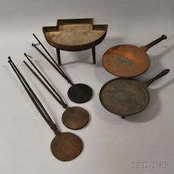 Three Wrought and Cast Iron Wafer Irons, a Stove Base, and Two Griddles