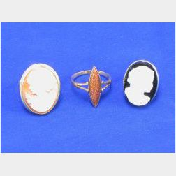 Two Carved Cameo Rings and Another Ring.