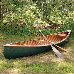 Arthur E. Levenseller 12-foot Canoe with Two Canoe Paddles.     Estimate $1,000-1,500
