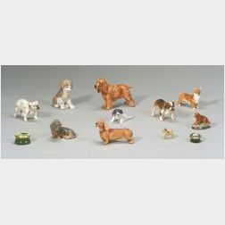 Twelve Small Canine Figurines and Boxes