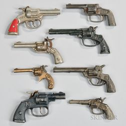 Eight Small Cast Iron Toy Cap Guns
