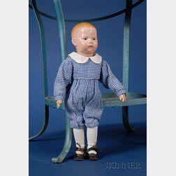 Small Schoenhut Sober-Faced Boy Doll