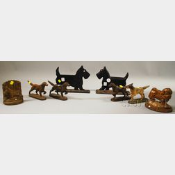 Four Cast Iron Dog Figural Doorstops, a Bookend, a Doorstop, and Two Bootscrapers