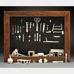 Shadow Box Mounted with Miniature Carved Bone Tools and Household Implements