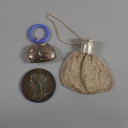 Sterling Silver Rabbit Rattle, Mesh Reticule, and a Commemorative Queen Victoria Medallion.     Estimate $75-125