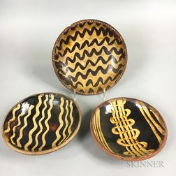 Three Slip-decorated Redware Plates