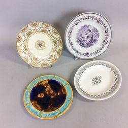 Four Ceramic Plates